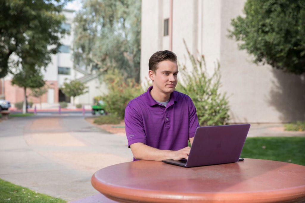 GCU Student at computer